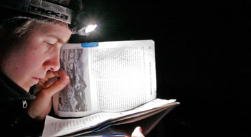 Reading the Pacific Crest Trail guidebook by night. Photo by Philipp Kobel