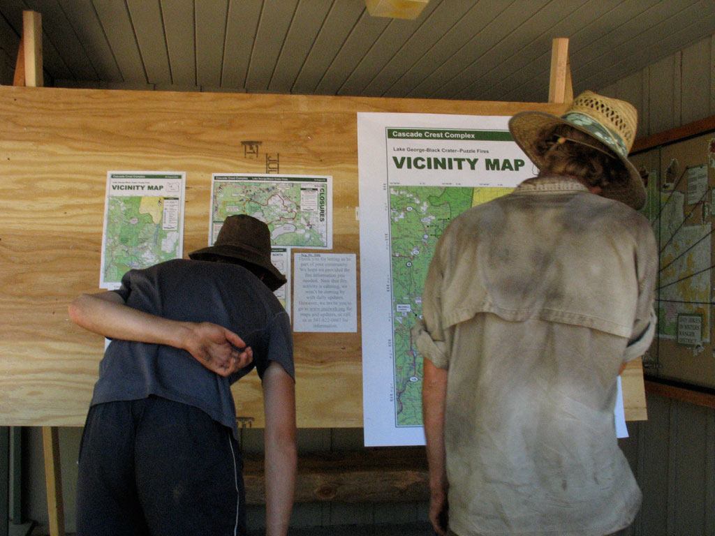 Thruhikers reading information about a fire closure that forced them to skip around. Photo by Jack Haskel