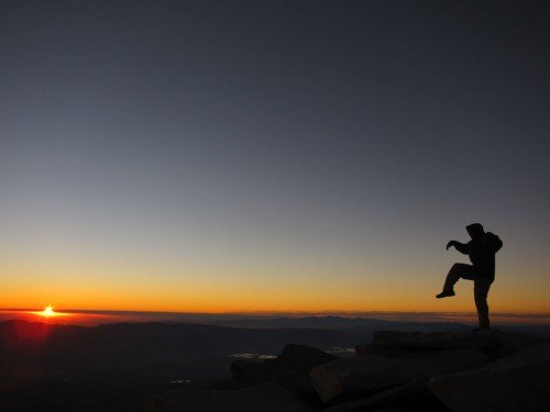 A John Muir Trail thru-hiker on the summit of Mt. Whitney. Photo by Jack Haskel