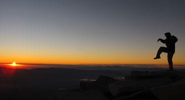 John Muir Trail thru-hiker on the summit of Mt. Whitney. Photo by Jack Haskel
