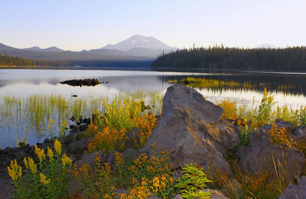The sunrise rises at Elk Lake, OR. Photo by Eric Valentine