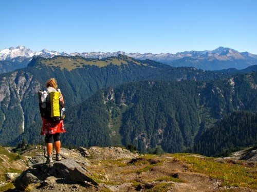 A thru-hiker surveys the view from Fire Creek Pass in Glacier Peak Wilderness. Photo by Stephanie White