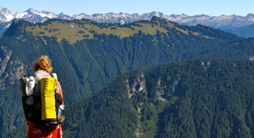 A hiker surveys the view from Fire Creek Pass in Glacier Peak Wilderness. Photo by Stephanie White