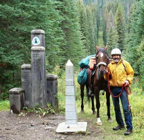 """Ed """"MendoRider"""" Anderson at the northern terminus of the PCT with his horse Primo."""