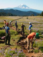 2013 Photo Contest - Trail Work - Second Place Trail crew putting in check steps below Old Snowy in the Goat Rocks Wilderness with Mount Adams to the south.  Photo by: Linda Rostad