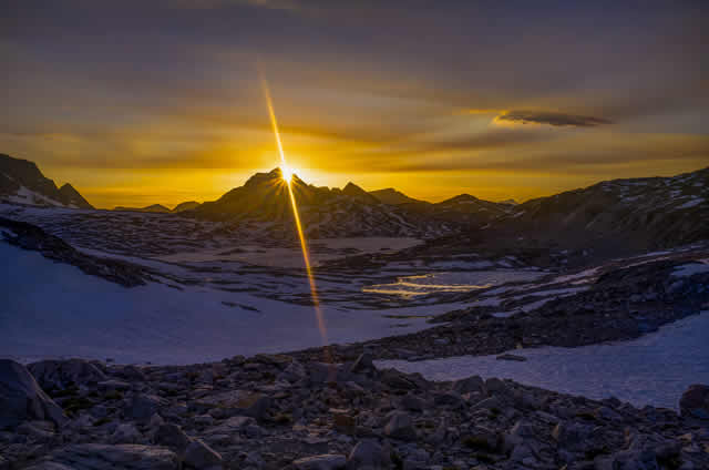 2013 Photo Contest - Trail Majesty - First Place I witnessed this spectacular sunset from the front steps of the Muir Hut in late May. Lake McDermand and Wanda Lake are visible in the background.  Photo by: Vit Hradecky