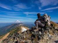 2013 Photo Contest - Human Spirit - Honorable Mention Alasdair 'Blackbeard' Fowler looks across Goat rocks towards Mount Rainier.  Photo by: Alasdair Fowler