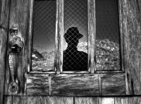 2013 Photo Contest - Human Spirit - Third Place Muir hut reflects the silhouette of a hiker during a brief lunch stop after achieving the summit of Muir Pass, Sierra Nevada, Calif.  Photo by: Ryan Weidert