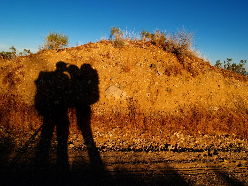 Aaron and Nathalie kissing in the Mojave. [Photo by Aaron Doss]