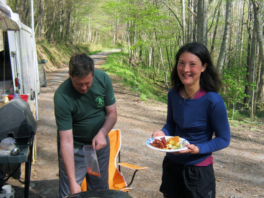 Liz Thomas enjoying a free meal from the Rat Pack (a group of trail maintainers) at Brown Gap on the Long Trail.