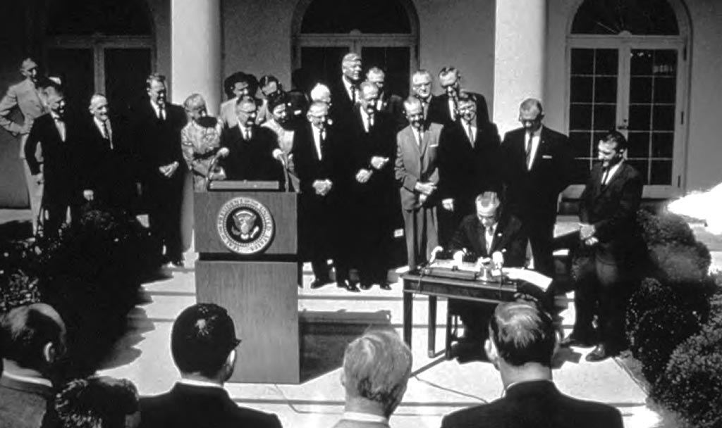 President Lyndon Johnson signs the Wilderness Act into law. Photo via the Library of Congress.