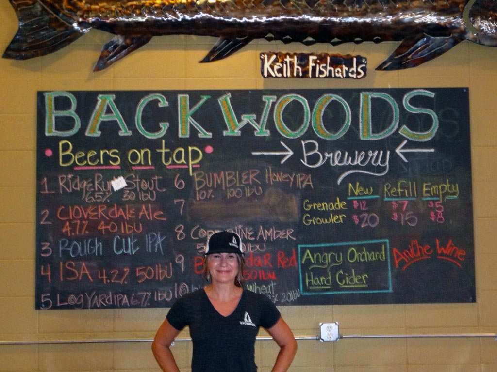 Greta Hollis, a friendly face at Backwoods Brewing, treats hikers really hard well.