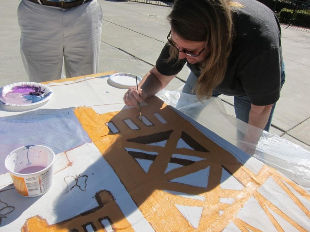 Beth Southorn, of LifeSTEPS, paints Sacramento's Tower Bridge.