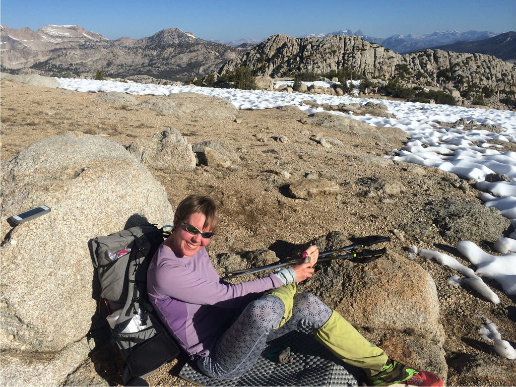 """This is me in the Sierra saying, """"I'm going to keep icing my injured foot with snow and then I will hobble all the way to Canada. Because I'm a tough thru-hiker! GRRR!"""""""