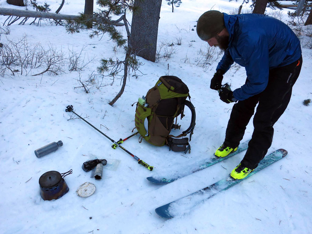 The brutal act of needing to heat up water over an alcohol stove in order to de-ice your ski binding.