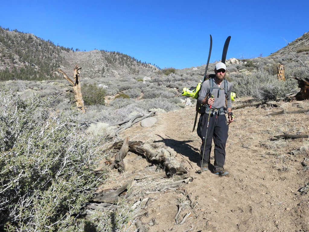 Walking dry trail in the Southern Sierra, with skis on back, is a sign of the terribly dry winter the western United States is experiencing.