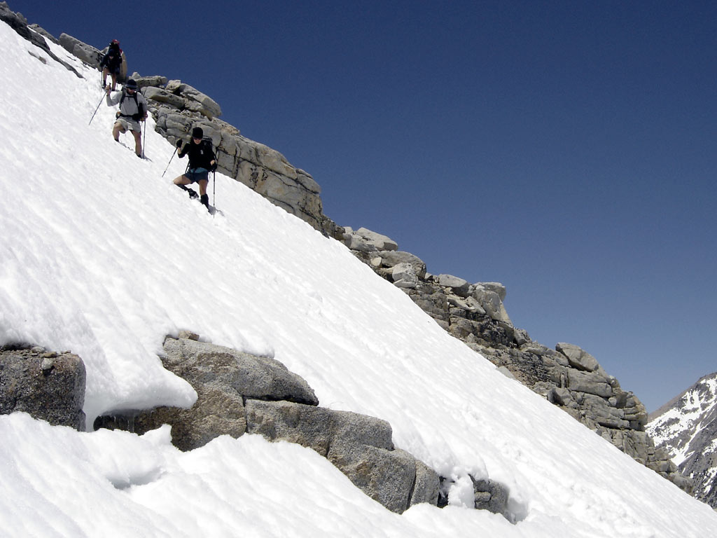 Firm snow can linger well into summer on the northern reaches of the PCT. Hikers should wait for the snow to melt unless they have the skills and tools needed for crossing steep and dangerous snow-covered slopes, where the risk of a fall can be significant