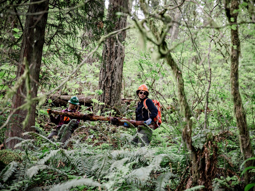 Trail crew volunteers moving a log in Oregon. Photo: Gray Feather Photography.