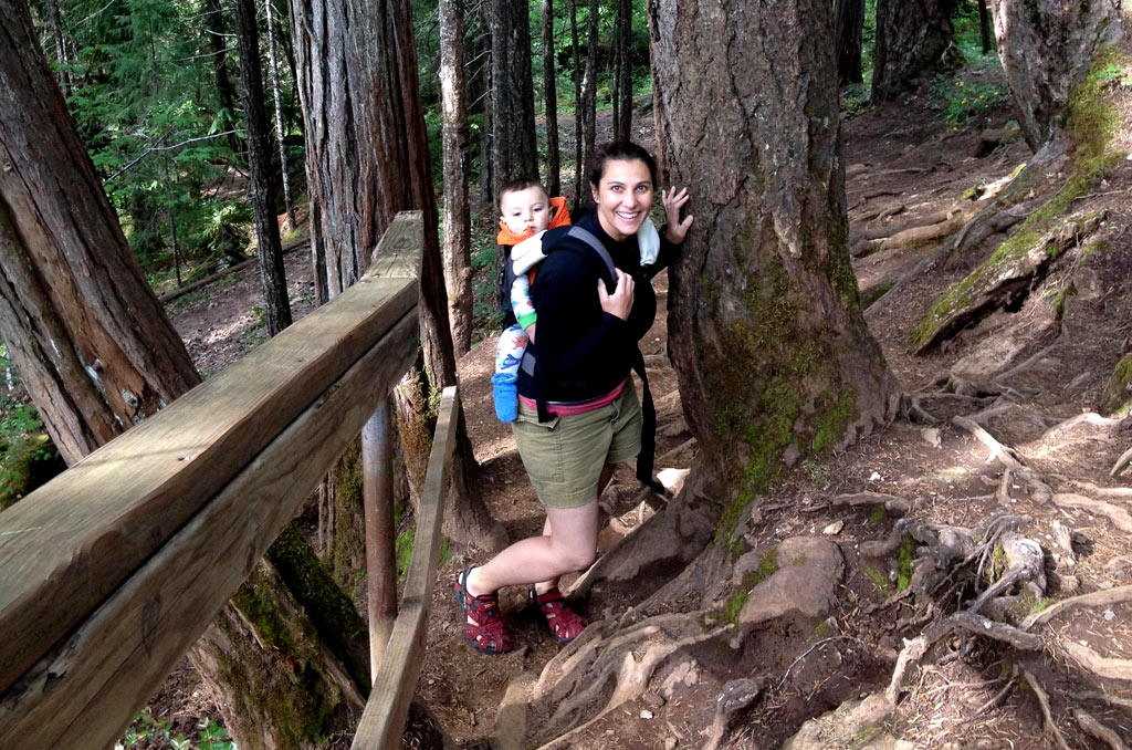 Shanti Hodges hiking with her baby on her back in Southern Oregon.