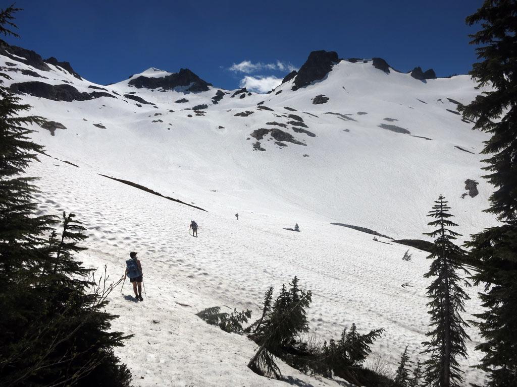 Crossing a snowfield in the Glacier Peak Wilderness in mid-July 2014. Photo by John Haffner.