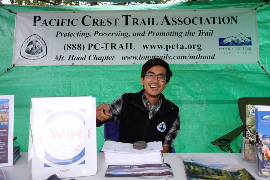 Lanz Nalagan, part of PCTA's philanthropy department, manning our booth.