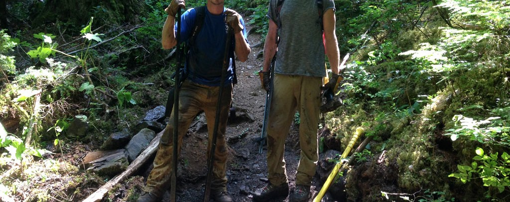 Justin and Wes working to armor a stream crossing with rocks.