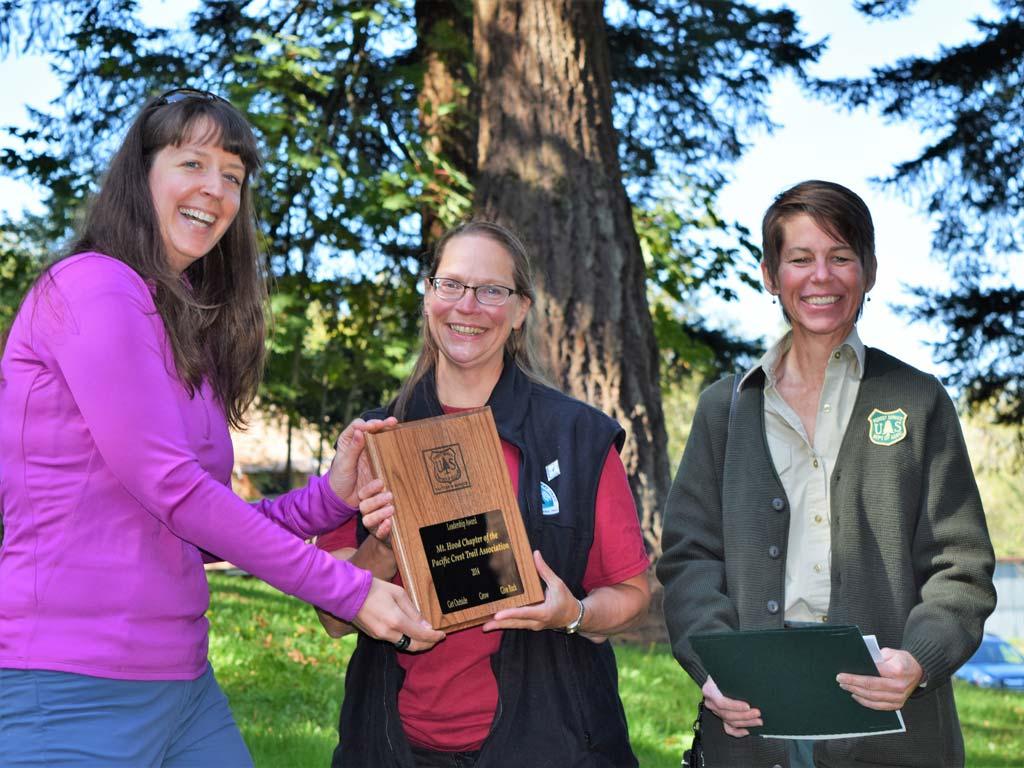 Jennifer Wade & Lisa Northrop present the 2014 Forest Service Volunteers & Service Leadership Award to Mt. Hood Chapter Chair, Roberta Cobb. Photo by Liz Marriott