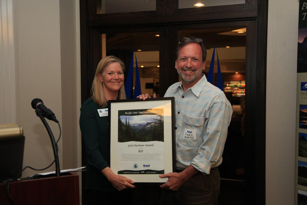Marc Berejka, REI's Director of Community and Government Affairs, receives an award on behalf of REI.