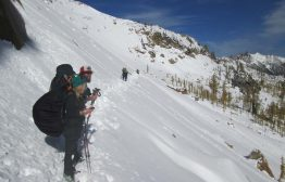 PCT hikers crossing a slope that's steep enough to avalanche. Fall 2013. Photo by Carolyn Burkhart