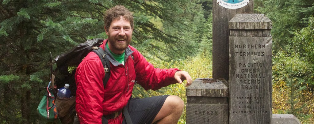 Colin Arisman at the northern terminus of the Pacific Crest Trail.