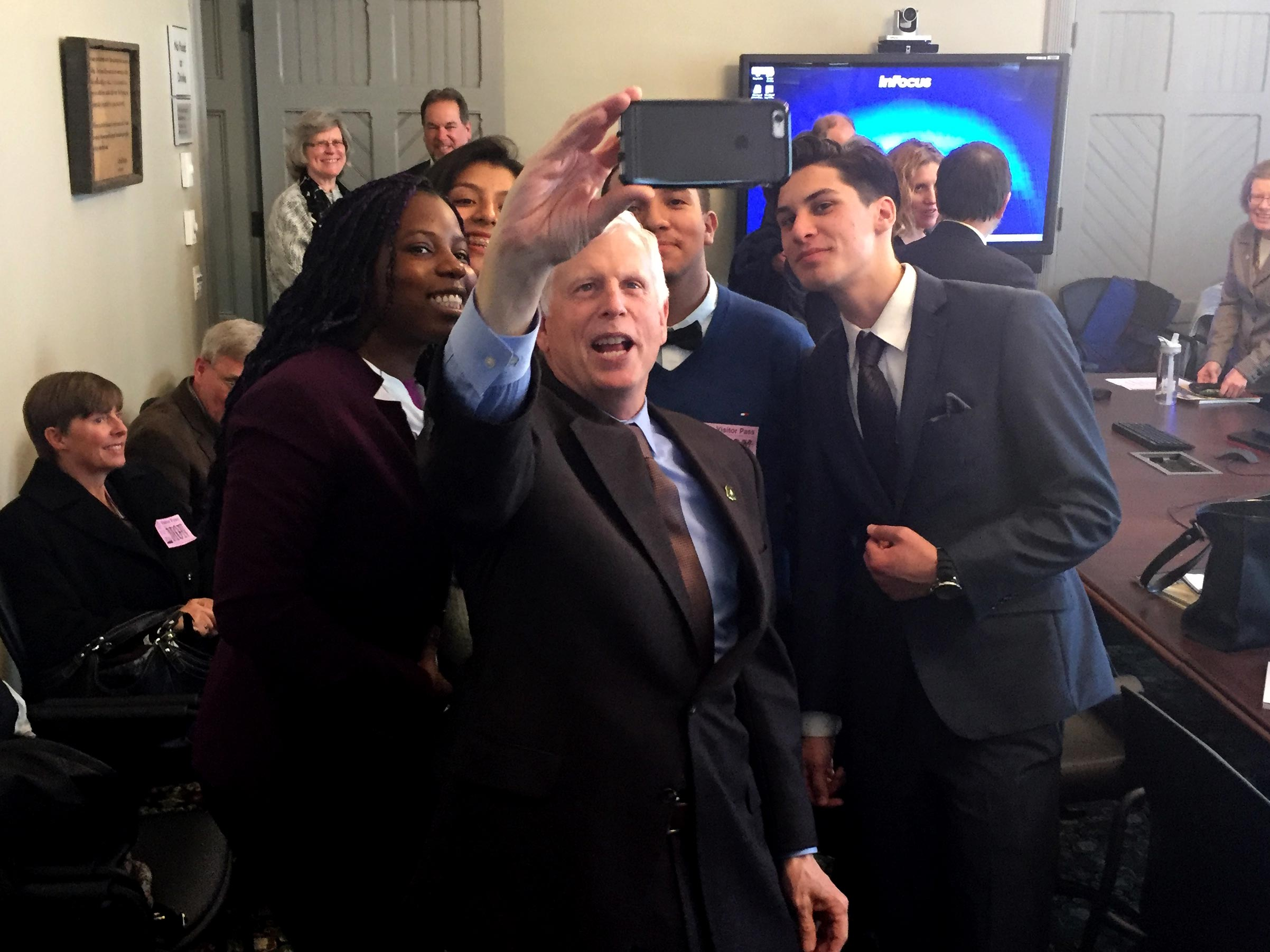 Chief Tidwell, leader of the U.S. Forest Service, takes a selfie with the group after hearing them speak about how important the PCT is to them.