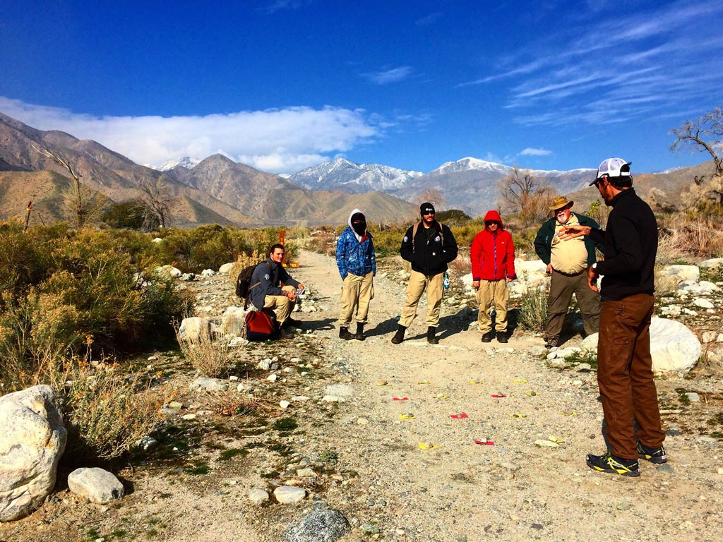 The NCCC Americorps team listening to a Leave No Trace training put on by PCTA staffer Ben Barry.