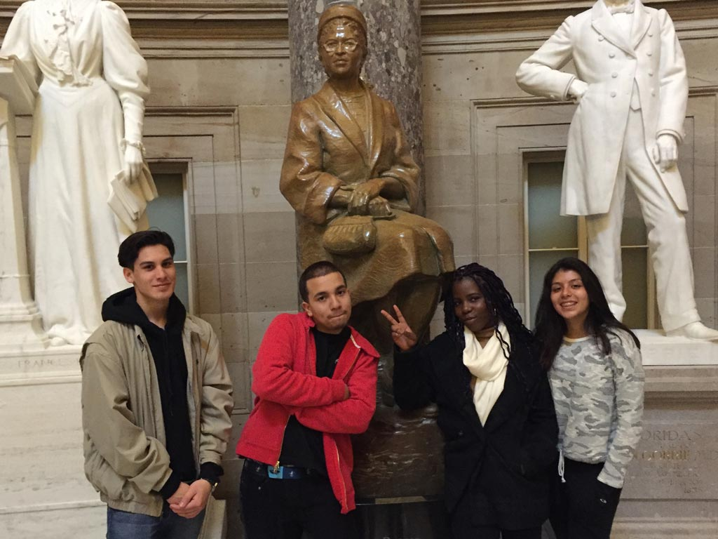 "PCT hiker ""Special Agent"" gave the students a behind the scenes tour of the Capitol. Here they are with the Rosa Parks statue."