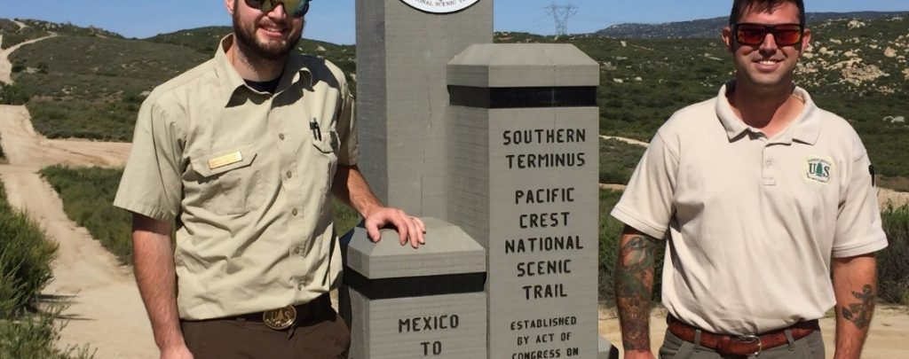 The Crest Runners stand at the Southern Terminus of the Pacific Crest Trail. They work for Cleveland National Forest.