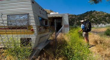 PCT Land Protection program photo with old trailers on private land shown as a threat to the Pacific Crest Trail.