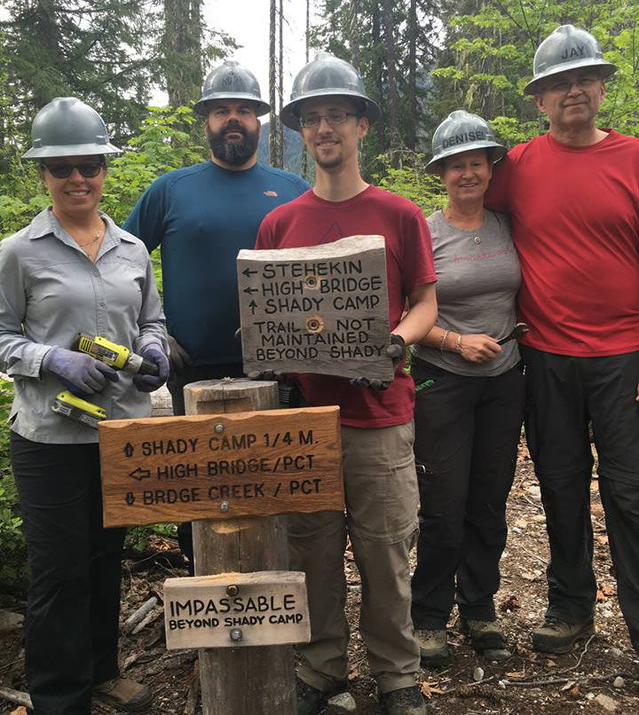 (Left to right) Shannon Cunningham, Rudy Giecek, Dereck Catron, Denise Crafton and Jay Crafton installed news signs along the trail.
