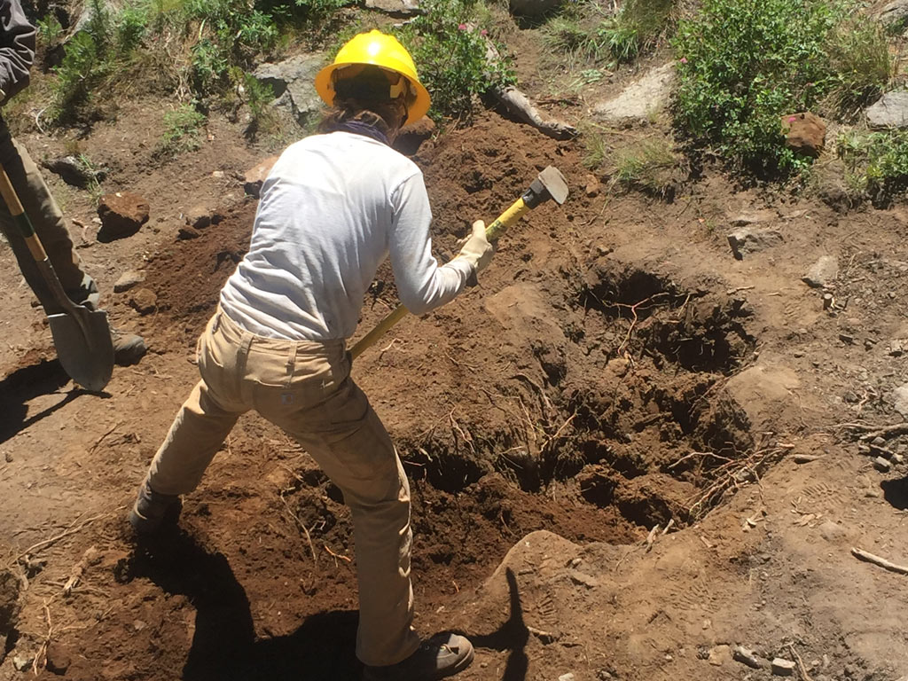 digging a hole at the northern sierra trail skills college in 2016