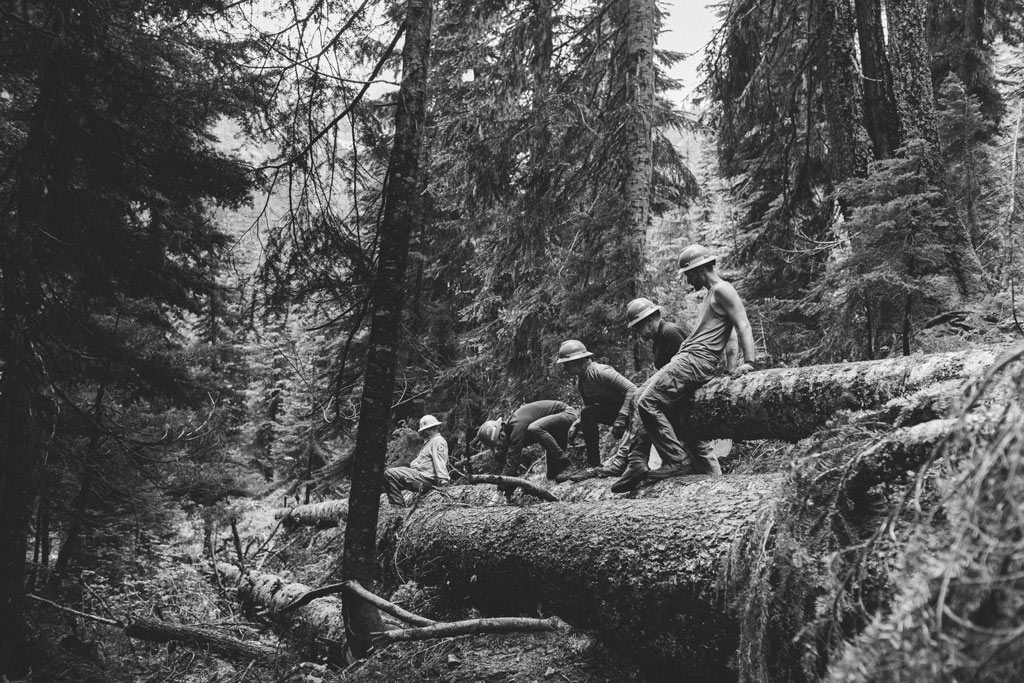 Volunteers from Uphill Designs push logs off the Pacific Crest Trail with the PCTA North 350 Blades. Photo by Vincent Carabeo/Uphill Designs.
