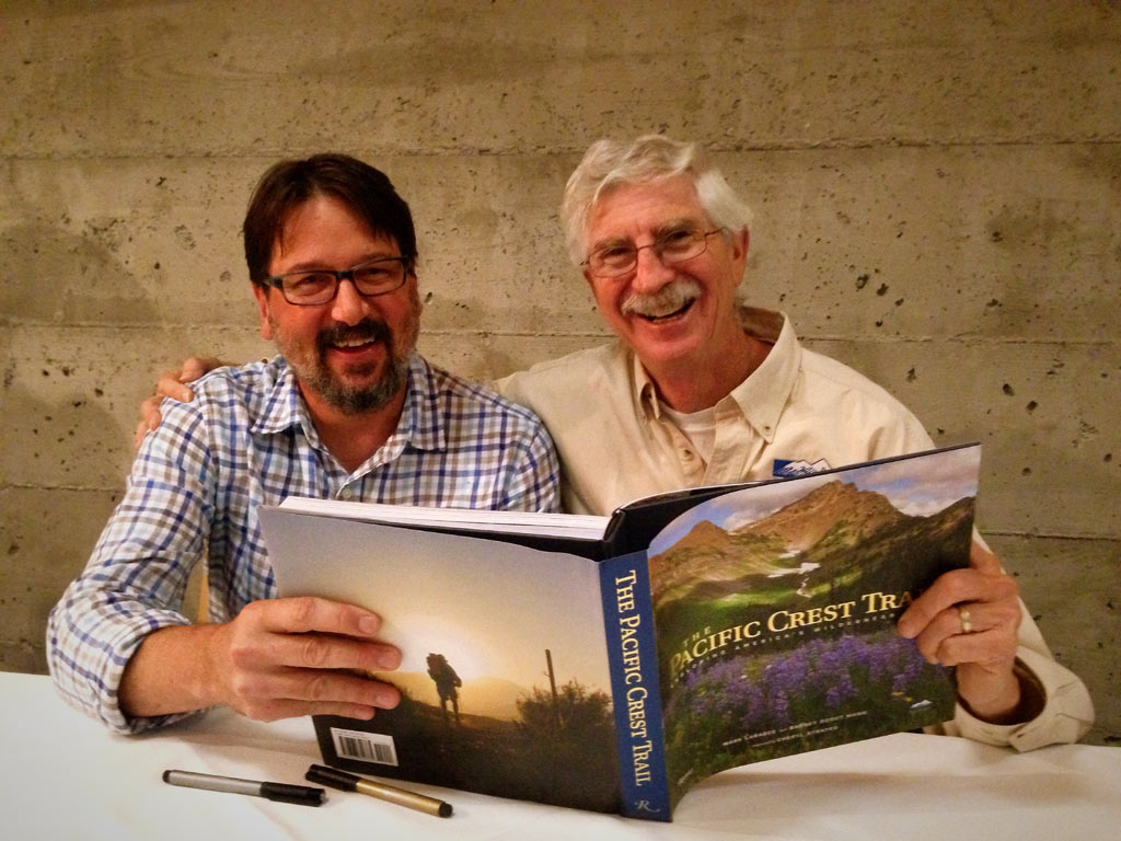 "PCTA Managing Editor Mark Larabee (left) and Board Member Barney ""Scout"" Mann signing copies of The Pacific Crest Trail: Exploring America's Wilderness Trail. Photo by: Alice Su"