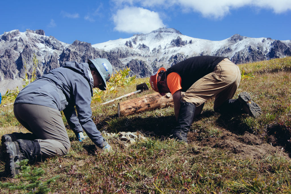 Setting sign posts at Yakima Pass with fresh snow in the high elevation parts of Goat Rocks Wilderness. Photo by Liz Donovan.