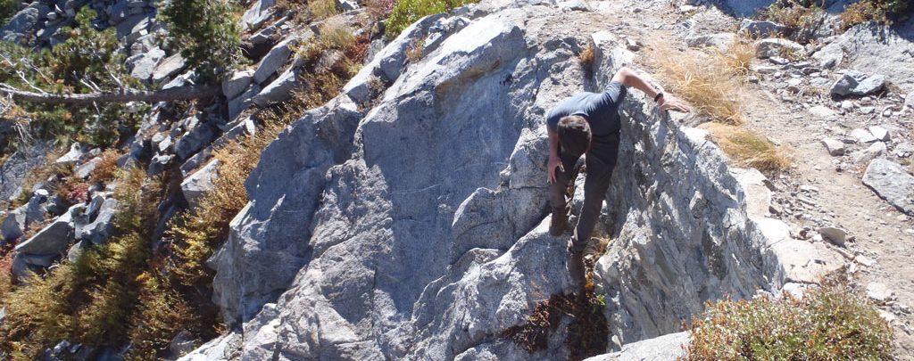 Klamath National Forest's Sam Commarto investigates a rock wall.