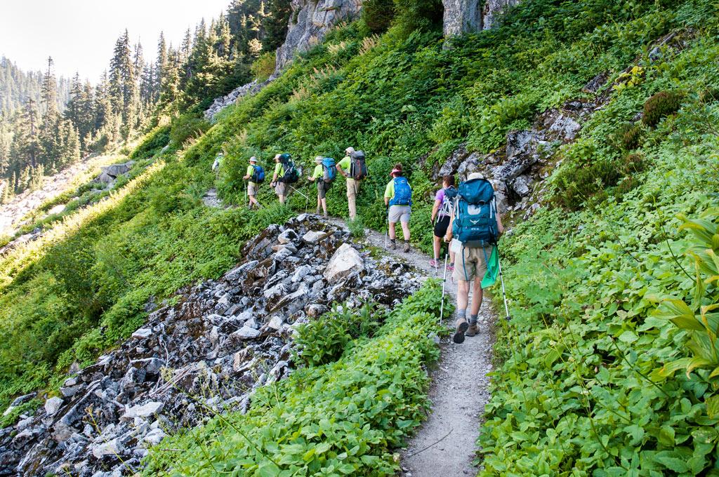 hikers-walking-in-line