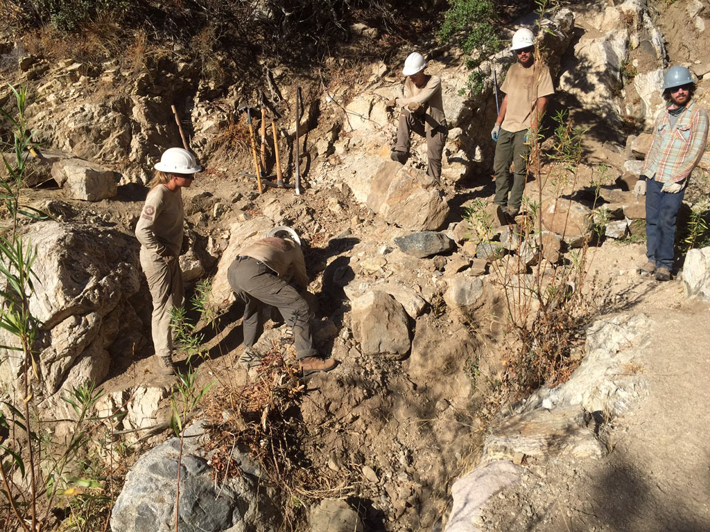Corp crew and volunteers building a rock retaining wall. Photo by Connor Swift