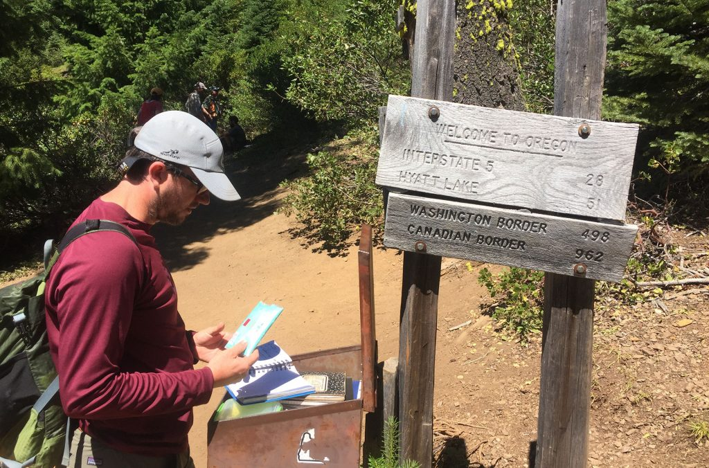 PCTA Regional Representative Ian Nelson on the Pacific Crest Trail at the California-Oregon border. The border is north of the Donomore Meadows property.