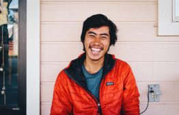 "Vincent ""Snuggles"" Ly takes a break and shares some laughs in Etna, California. Photo by Karen Wang"