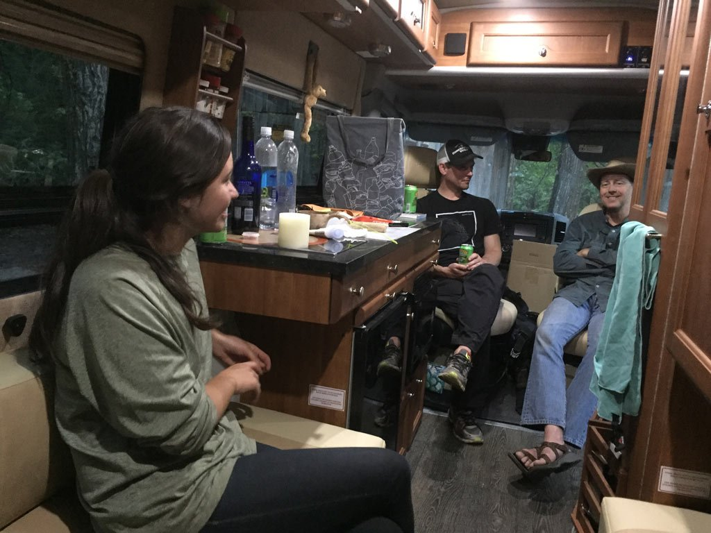 Brenna Hurst, Kevin Broch and Ken Geib hang out near the project site in Ken's RV. Wild Plum Campground.