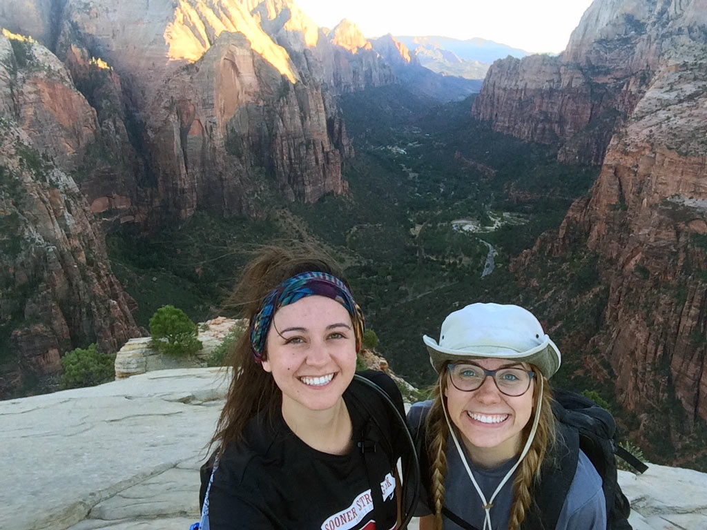 Brenna Hurst and Allyson Wiley on top of Angels Landing in Zion National Park.