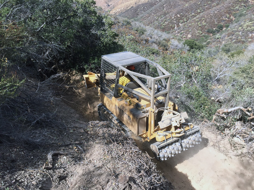 Sweco Trail Machine at work. These are rarely used on the PCT. Photo by Conner Swift