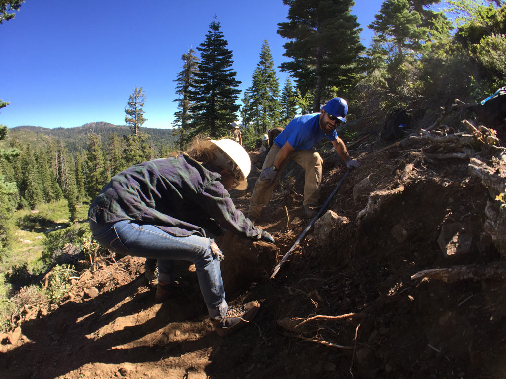 Allyson Wiley and Connor Swift building trail.