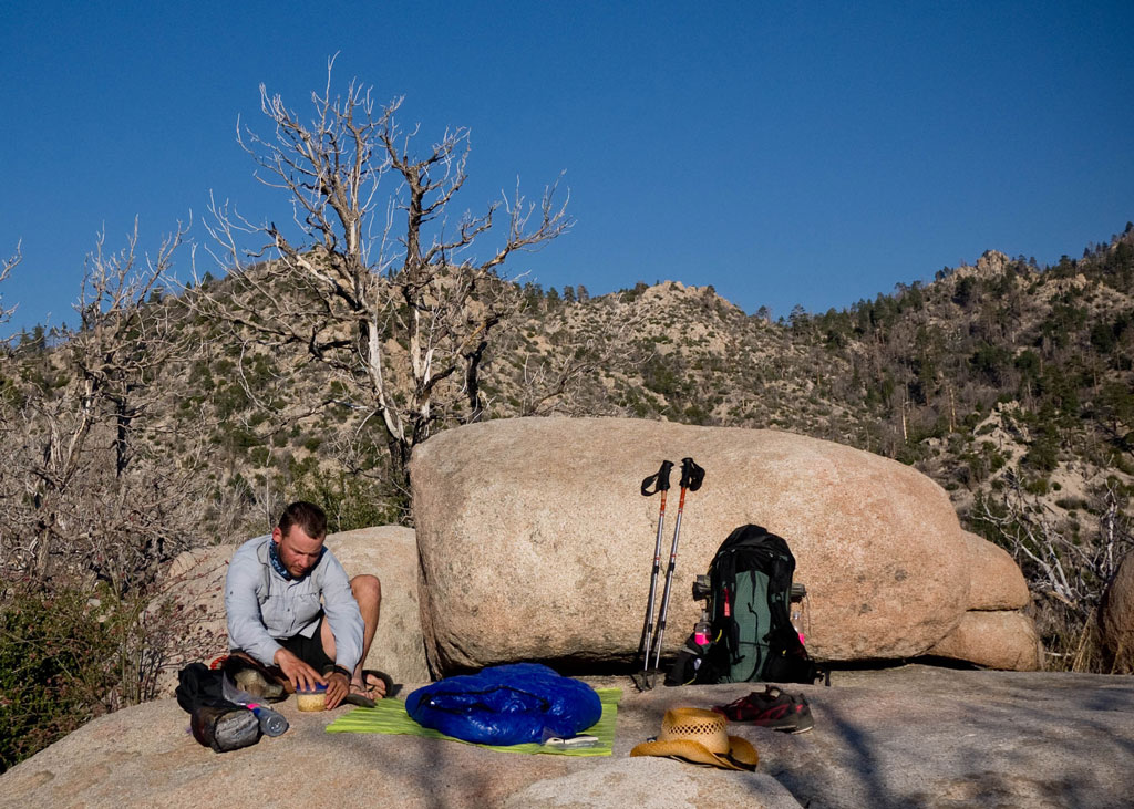 A thru-hiker makes camp on a durable surface: a boulder. He won't be leaving compacted soil, damaged plants or an obvious camp behind. Photo by Ethan Gehl